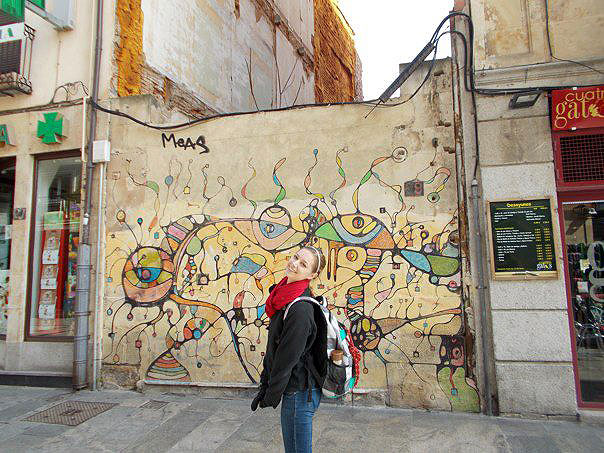 Aly with street art in the city.