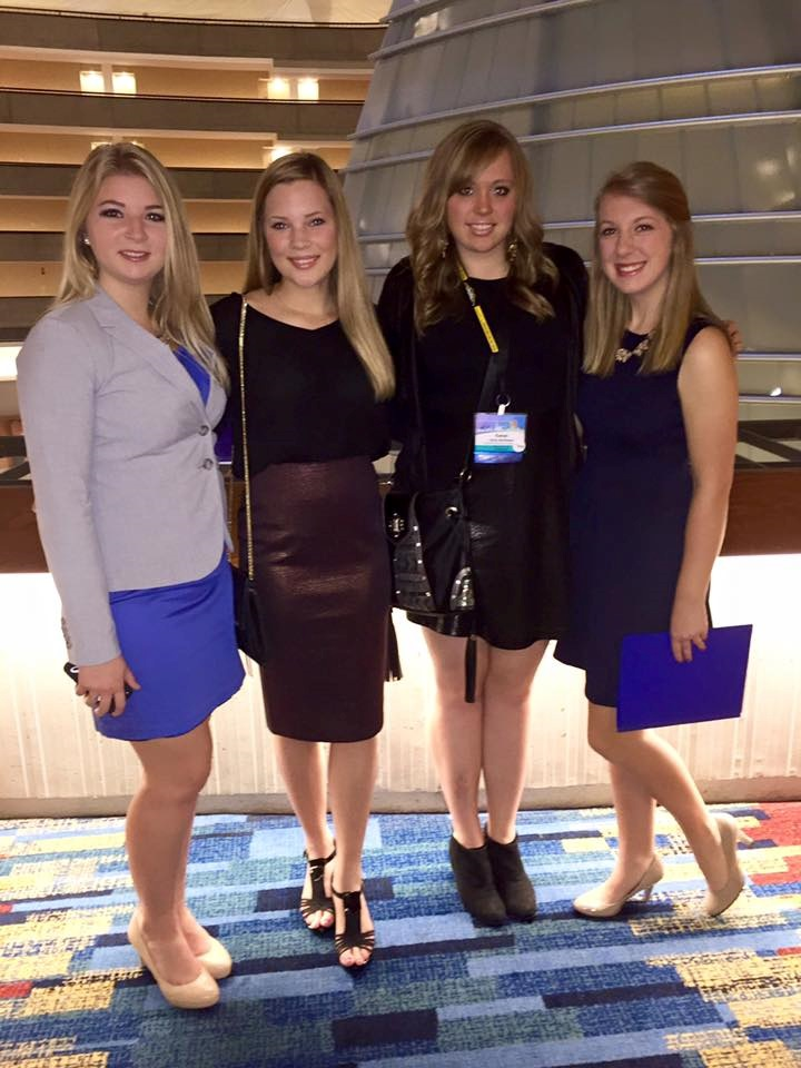 Chloe Wiersma (second from left) enjoys networking with other Pointers including these recent alumnae.