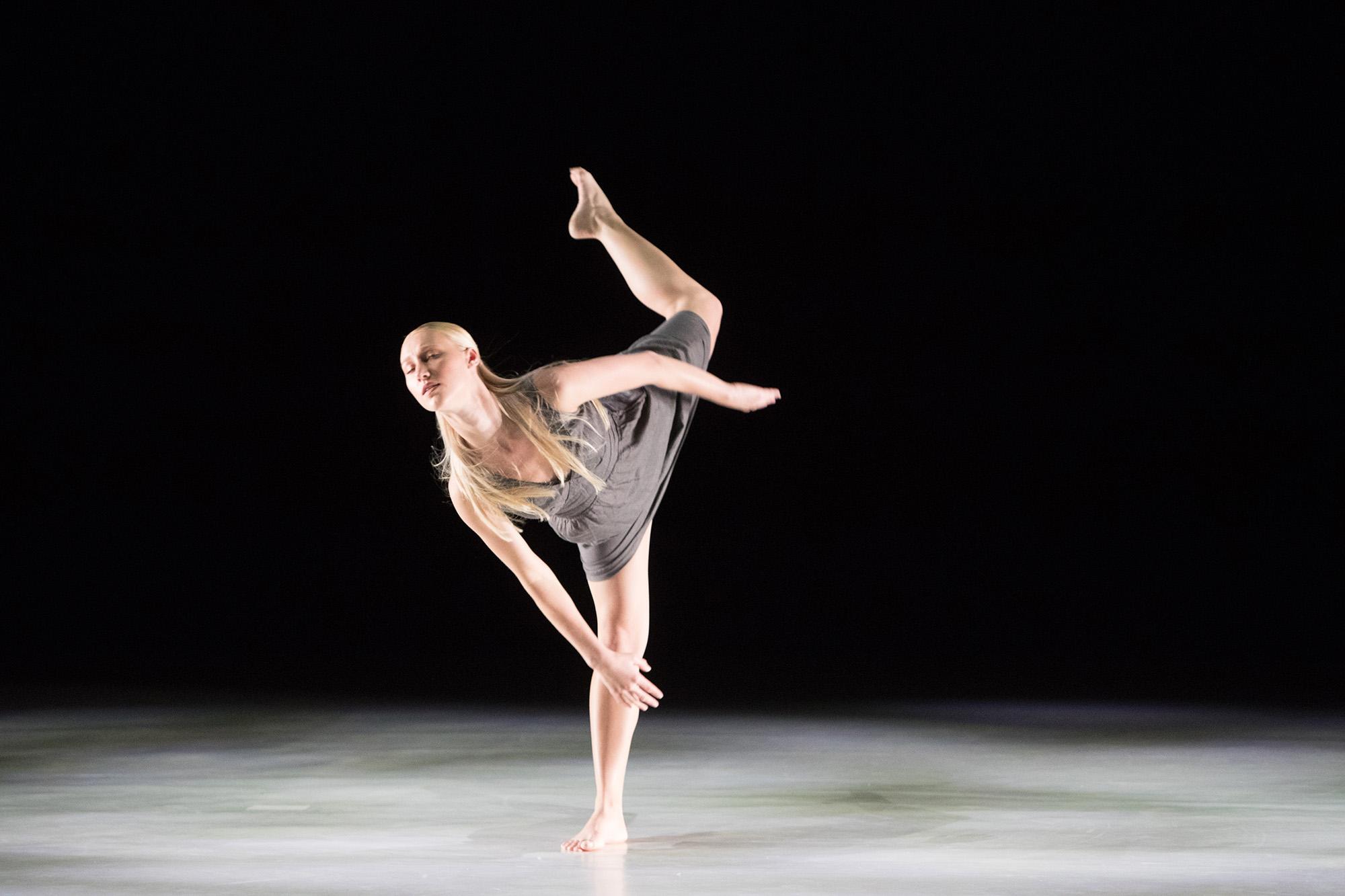 Student dancing onstage for Dansstage.